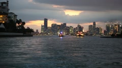 Fireboat in Foreground of Miami Cityscape at Night Stock Footage
