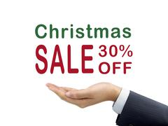 Christmas sale 30 percent off holding by businessman's hand Stock Photos