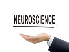 Neuroscience word holding by businessman's hand Kuvituskuvat