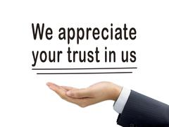 We appreciate your trust in us holding by hand Stock Photos