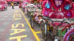 Parking rickshaws on the  Dutch Square in Malacca. Stock Footage