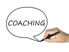 Coaching word written by human hand Stock Photos