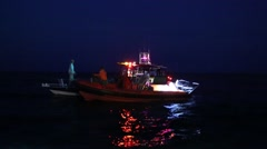 US Customs Boat Commandeers Boat on Water at Night - stock footage