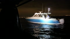 Boat at Night in Spotlight and Blue Lights of Police Boat Stock Footage