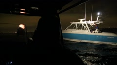 Boat at Night in Spotlight and Blue Lights of Police Boat - stock footage