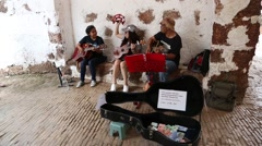 Street musicians play and sing in Malacca, Malaysia Stock Footage