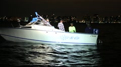 Customs Patrol Boat Spotlight Men in Boat Stock Footage