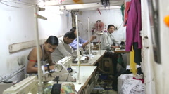 Men sewing clothes in a workshop in Mumbai. Stock Footage