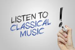 Hand writing listen to classical music Kuvituskuvat