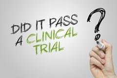 Hand writing did it pass a clinical trial - stock photo