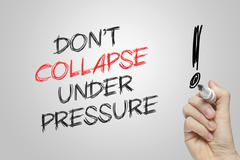 Hand writing don't collapse under pressure Stock Photos