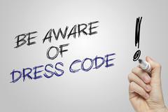 Hand writing be aware of dress code Stock Photos