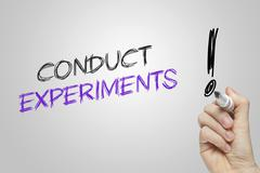 Hand writing conduct experiments Stock Photos