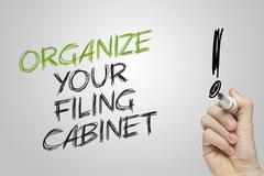 Hand writing organize your filing cabinet Stock Photos