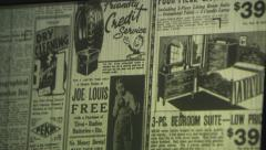 Close up o f microfiche viewing screen as newspaper spins through Stock Footage