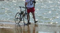 3395 Man Walking Bike Next to Lake with Camera in Washington DC, 4K Stock Footage