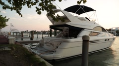 Stock Video Footage of Pan of Luxurious Boats in Dock at Sunset