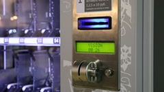 Inserting coins in money slot of vending machine Stock Footage