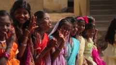 Little Indian girls smiling and waving in India Stock Footage