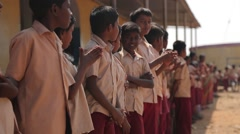 Little Indian boys applauding and smiling in the school yard in India - stock footage