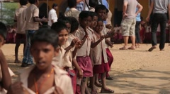 Little Indian boys applauding in the school yard in India - stock footage