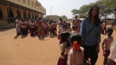 Indian children entering the school in line in India Stock Footage