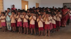 Little Indian children in uniforms praying in India Stock Footage