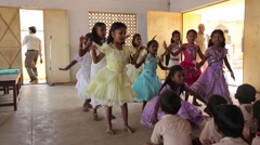 Little girls dancing in colorful dresses in India Stock Footage