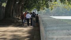 Sri Lankan people walking in the park in Colombo Stock Footage