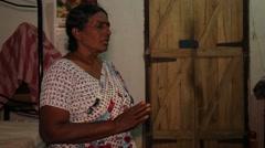 Sri Lankan woman praying Stock Footage