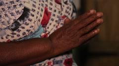 Woman hands folded in prayer in Sri Lanka Stock Footage