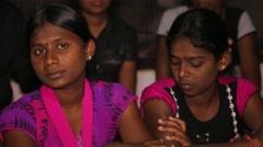 Sri Lankan girls sitting on floor at a gathering Stock Footage