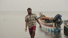 Man from Sri Lanka walking with fish in his hands Stock Footage