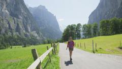 Hiking in Switzerland Swiss alps Bernese Oberland - Woman hiker tourist on hike Stock Footage