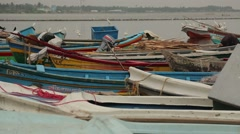 Colorful boats on the Indian Ocean shore in Sri Lanka Stock Footage
