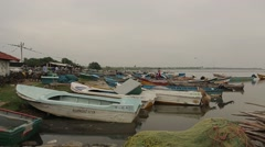 Boats anchored on the Indian Ocean shore in Sri Lanka - stock footage