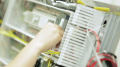 Tracking (dolly) shot of a work bench in an electronics factory Stock Footage