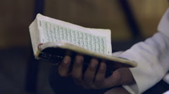 A Muslim man reads a koran Stock Footage
