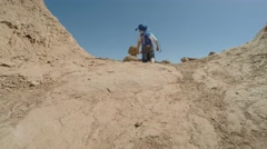 Family walking around in goblin valley state park rock formations Stock Footage