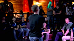 Bartenders show their skills in front of an admiring audience. - stock footage