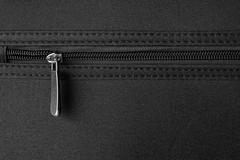 zipper on black - stock photo