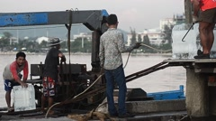 Worker preparing the ice in fishing boat at jetty Stock Footage