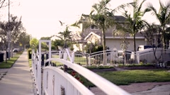 Suburban home on the sidewalk Stock Footage