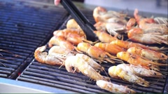 Cooking prawns on the grills Stock Footage