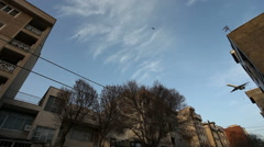 Airplanes flies over residential part of Tehran  Stock Footage