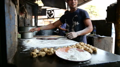 Indian man preparing dough for naan in workshop in Mumbai. Stock Footage