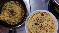 Cooking Russian Pancakes in Frying Pan Closeup. Stock Footage