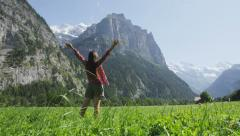 Happy free woman with arms raised serene in nature - stock footage