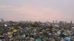 A rubbish dump at dawn Stock Footage