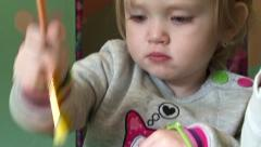 Little girl drawing diligently , close-up Stock Footage